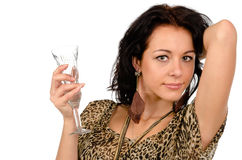 Woman enjoying a night out. Head and shoulders portrait of a stylish beautiful young woman enjoying a night out holding an elegant champagne flute in her hand Stock Photos