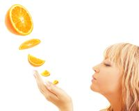 Woman enjoying orange Royalty Free Stock Photos