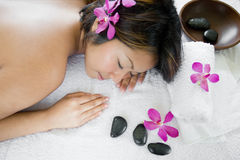 Woman enjoying the oriental spa Stock Images