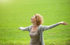 Woman enjoying the outdoors with arms spread open Royalty Free Stock Photos