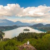 Woman enjoying panoramic view of Lake Bled, Slovenia. Stock Photo