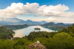 Woman enjoying panoramic view of Lake Bled, Slovenia. Royalty Free Stock Images