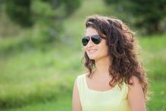 Woman enjoying in the park Stock Photo