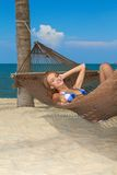 Woman enjoying the peace of a tropical beach Stock Image
