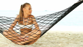 Woman enjoying the peace of a tropical beach Royalty Free Stock Photos