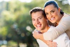Woman enjoying piggyback boyfriend Stock Image