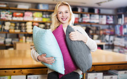 Woman enjoying purchased home textiles Royalty Free Stock Photos