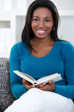 Woman in enjoying reading book Stock Images