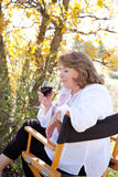 Woman enjoying red wine. Woman enjoying her red wine, taking the first sniff Stock Photography
