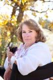 Woman enjoying red wine. Mature woman enjoying her red wine Royalty Free Stock Photos