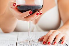 Woman enjoying red wine savouring the bouquet Royalty Free Stock Image