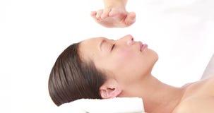 Woman enjoying a reiki treatment
