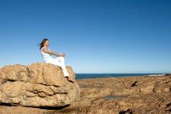 Woman enjoying retirement at ocean background Royalty Free Stock Image