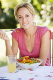 Woman Enjoying A Salad In A Garden Royalty Free Stock Images