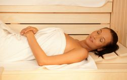 Woman enjoying sauna Royalty Free Stock Photos