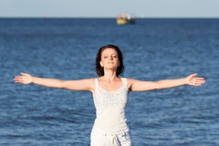 Woman enjoying  the sea Royalty Free Stock Photography