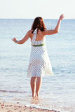 Woman enjoying  on  sea  beach Royalty Free Stock Images