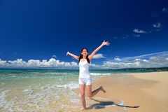 Woman enjoying the sea in Okinawa royalty free stock images