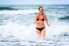 Woman enjoying the sea and waves of Atlantic ocean royalty free stock photo