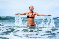 Woman enjoying the sea and waves of Atlantic ocean royalty free stock images