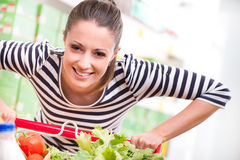 Woman enjoying shopping at supermarket Stock Images