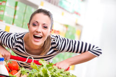 Woman enjoying shopping at supermarket Royalty Free Stock Photos