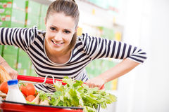 Woman enjoying shopping at supermarket Royalty Free Stock Photos