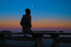 Woman enjoying the silence. During a wonderful sunset Royalty Free Stock Photography