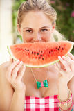 Woman Enjoying Slice Of Water Melon Stock Photo