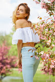 Woman enjoying smell in a flowering spring garden Royalty Free Stock Images