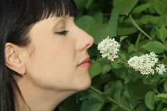Woman Enjoying Smelling aroma Flowers Royalty Free Stock Images