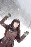 Woman enjoying snow Stock Images