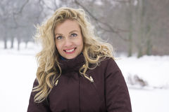 Woman enjoying snow in winter Stock Images