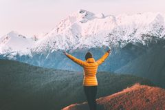Woman enjoying snowy mountains view adventure lifestyle solo traveling stock image