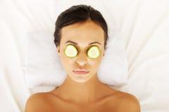 Woman enjoying spa, having cucumber on eyes Stock Images