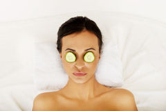 Woman enjoying spa, having cucumber on eyes Stock Image