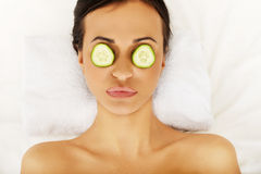 Woman enjoying spa, having cucumber on eyes Stock Photos