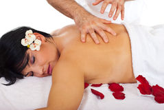 Woman enjoying a spa massage Stock Photography