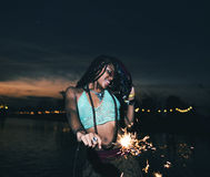 Woman Enjoying Sparkler in Festival Event stock photos