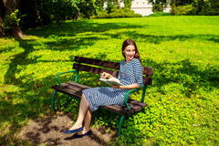 Woman enjoying spring in the park Stock Photos