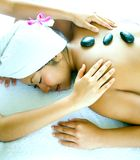 Woman enjoying stone therapy and massage Stock Image