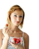 Woman enjoying strawberries Royalty Free Stock Image