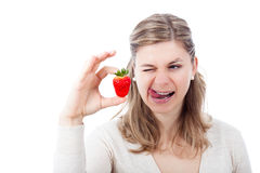 Woman enjoying strawberry Royalty Free Stock Photography