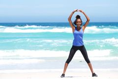 Woman enjoying stretching exercise at the beach Royalty Free Stock Photography