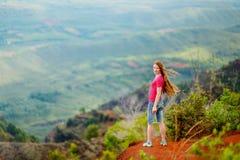Woman enjoying stunning view into Waimea Canyon Stock Image