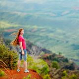 Woman enjoying stunning view into Waimea Canyon Stock Images