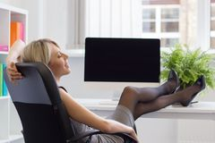 Woman enjoying successful day at work Stock Photos