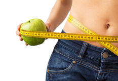 Woman enjoying successful weight loss Stock Photography