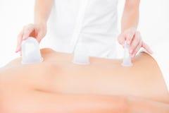Woman enjoying a suction back massage Stock Photo