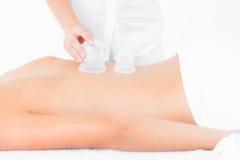 Woman enjoying suction massage Stock Photos